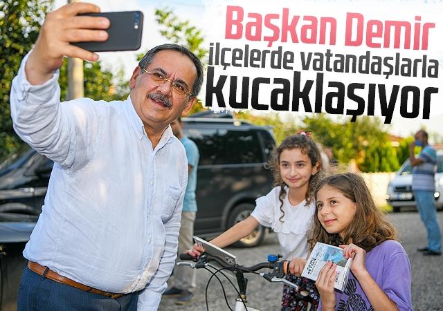 Başkan Demir, ilçelerde vatandaşlarla kucaklaşıyor